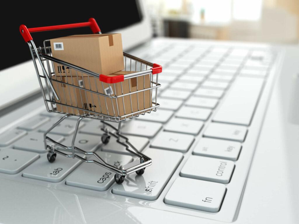 Ecommerce shopping cart on laptop keyboard